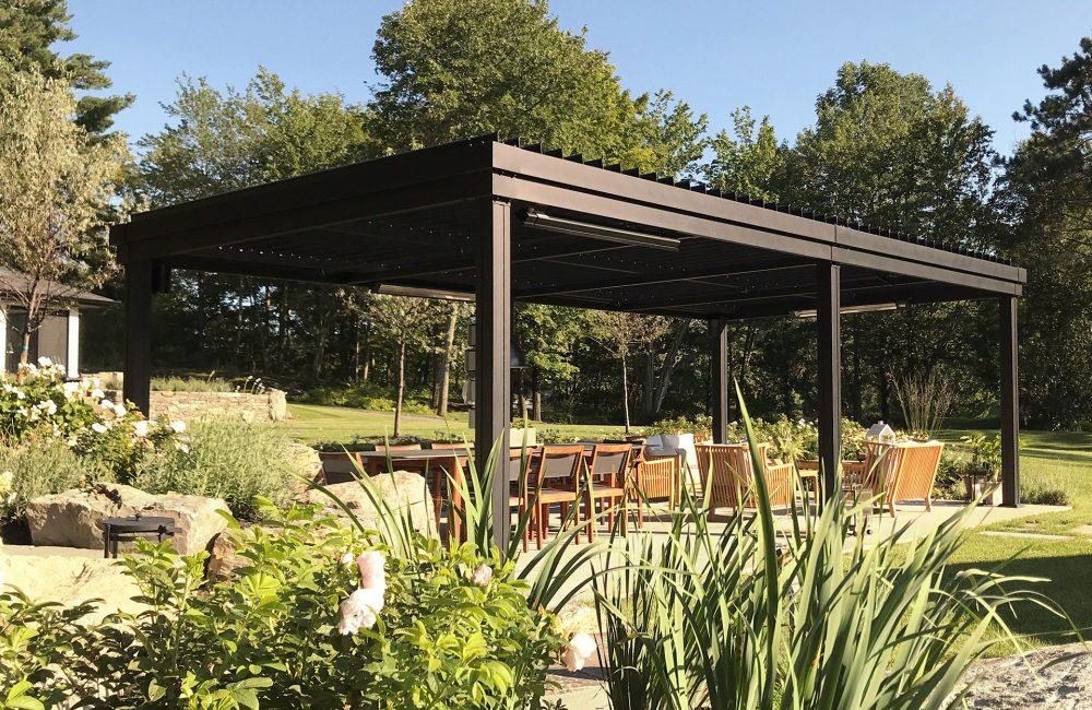 SunLouvre Pergolas Integrated Louvers model in the garden
